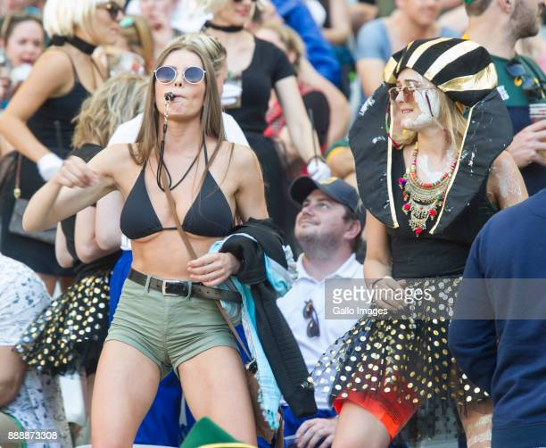 Spectators cheer during day 1 of the 2017 HSBC Cape Town Sevens at Cape Town Stadium on December 09 2017 in Cape Town South Africa