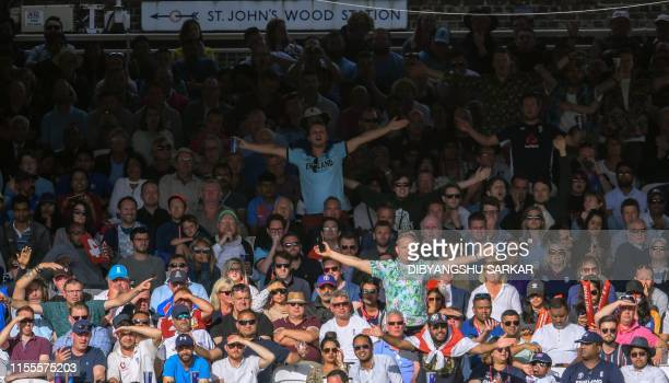 Spectators cheer during the 2019 Cricket World Cup final between England and New Zealand at Lord's Cricket Ground in London on July 14 2019 /...