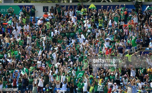 Spectators cheer during the 2019 Cricket World Cup group stage match between Pakistan and Afghanistan at Headingley in Leeds northern England on June...