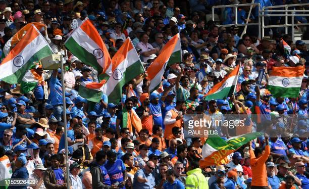 Spectators cheer during the 2019 Cricket World Cup group stage match between England and India at Edgbaston in Birmingham central England on June 30...