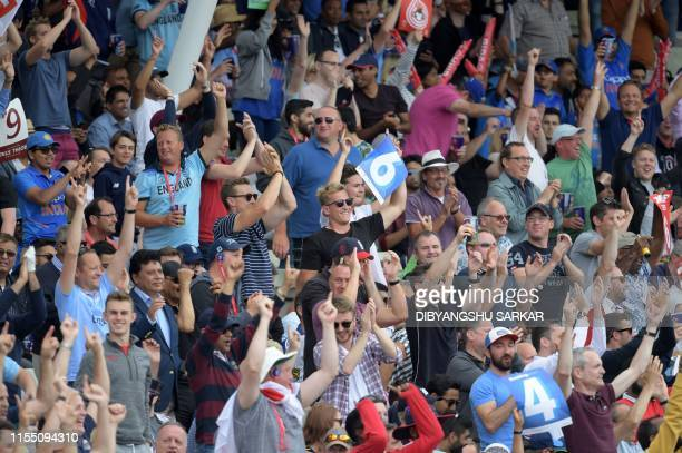 Spectators cheer during the 2019 Cricket World Cup second semifinal between England and Australia at Edgbaston in Birmingham central England on July...