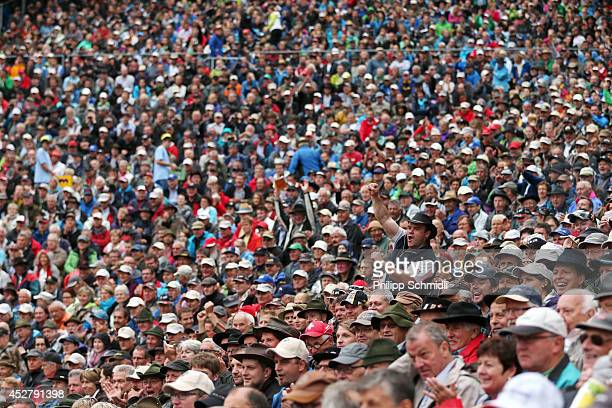 Spectators cheer during the Alpine Wrestling Festival BruenigSchwinget at the top of the Bruenig Pass on July 27 2014 in Meiringen Switzerland