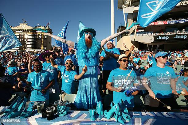 Spectators cheer during the Big Bash League match between the Adelaide Strikers and the Hobart Hurricanes at Adelaide Oval on January 6 2017 in...