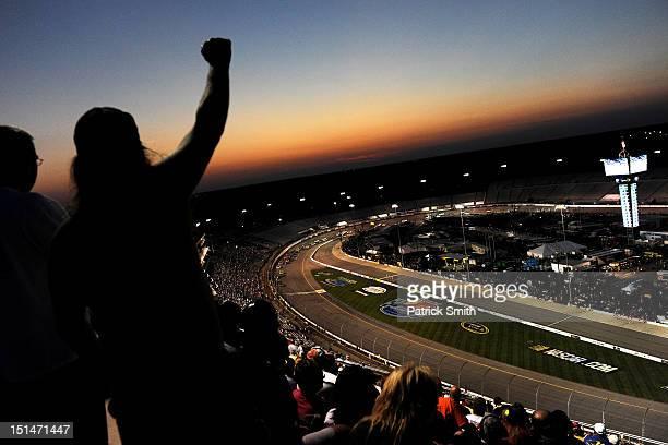 Spectators cheer during the NASCAR Nationwide Series Virginia 529 College Savings 250 at Richmond International Raceway on September 7 2012 in...