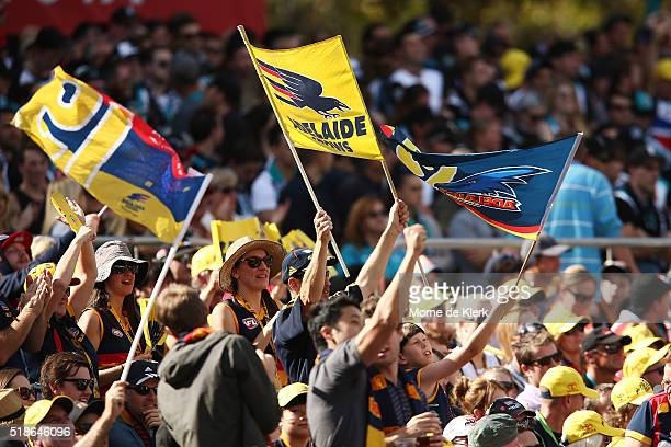Spectators cheer during the round two AFL match between the Adelaide Crows and the Port Adelaide Power at Adelaide Oval on April 2 2016 in Adelaide...
