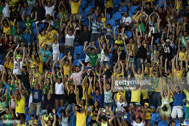 Spectators cheer during the Women's Group E first round match between South Africa and China PR on Day 1 of the Rio 2016 Olympic Games at the Olympic...