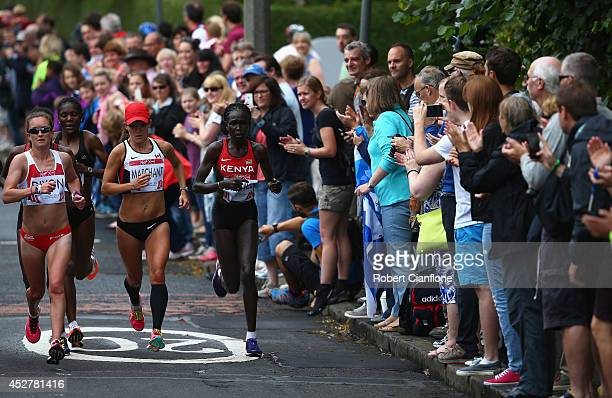 Spectators cheer during the Women's Marathon during day four of the Glasgow 2014 Commonwealth Games on July 27 2014 in Glasgow United Kingdom