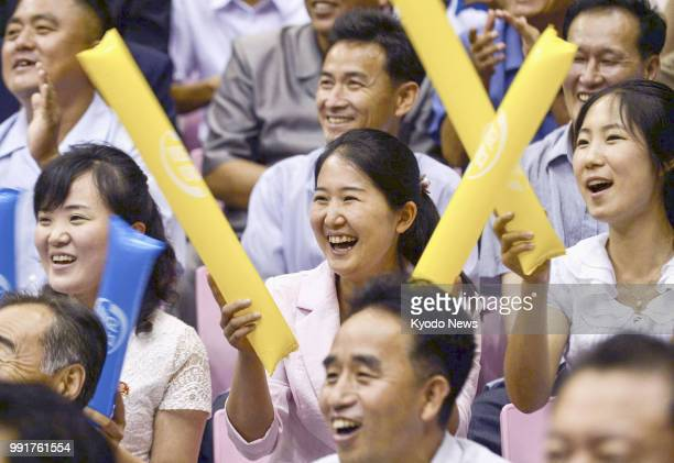 Spectators cheer for mixed teams of North and South Korean basketball players during their friendly matches in Pyongyang on July 4 2018 The event was...