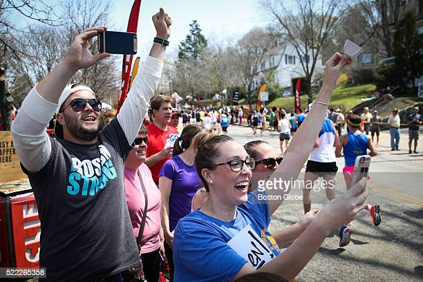 Spectators cheer for runners along Commonwealth Avenue near 'Heartbreak Hill' in Newton Mass during the 120th Boston Marathon on April 18 2016