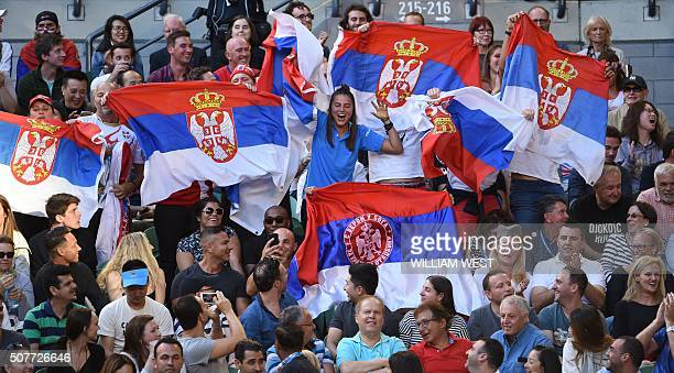 Spectators cheer for Serbia's Novak Djokovic during his men's singles final match against Britain's Andy Murray on day fourteen of the 2016...