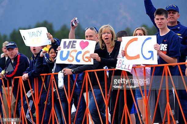Spectators cheer for the athletes during the cycling competition of the Warrior Games at the Air Force Academy on Tuesday May 5 in Colorado Springs...