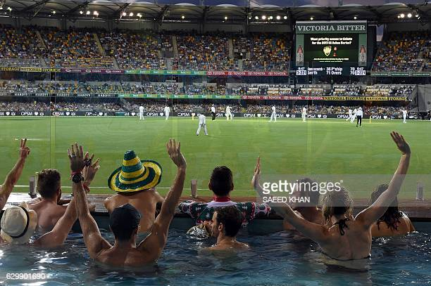 Spectators cheer inside a pool during the first day-night cricket Test between Australia and Pakistan at the Gabba in Brisbane on December 15, 2016....