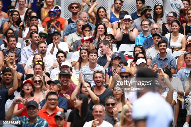 Spectators cheer on Fabio Fognini of Italy after winning his third round match against Julien Benneteau of France on day six of the 2018 Australian...