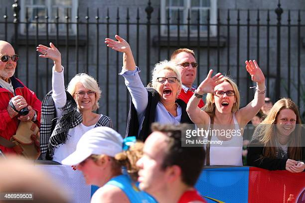 Spectators cheer on family and friends during the 2014 London marathon