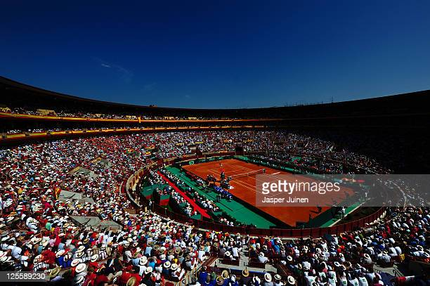 Spectators cheer on Rafael Nadal of Spain and Jo-Wilfried Tsonga of France during the third and final day of the semi final Davis Cup match between...