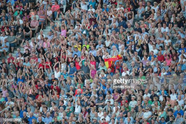 Spectators cheer on the athletes during the 800m race of the women's pentathlon on August 10 2018 in Berlin Germany