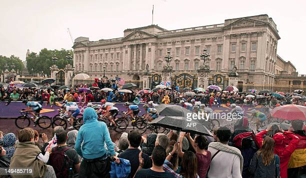 Spectators cheer on the peloton as they ride to the finish line of the women's cycling road race on The Mall in London on July 29 for the 2012 London...