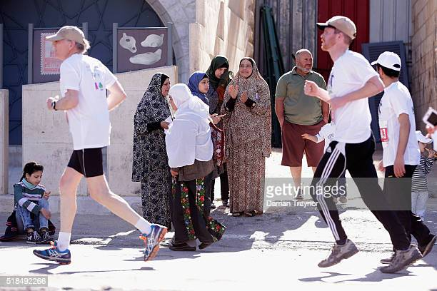 Spectators cheer on the runners during the Right to Movement Marathon in the West Bank city of Bethlehem on April 1 2016 in Bethlehem West Bank...
