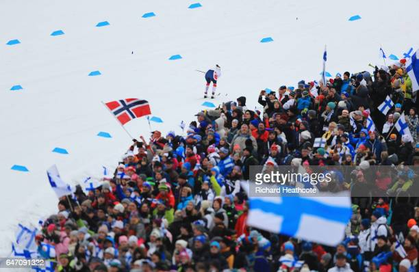 Spectators cheer on the skiers as they compete during the Women's Cross Country 4x5km Relay at the FIS Nordic World Ski Championships on March 2,...
