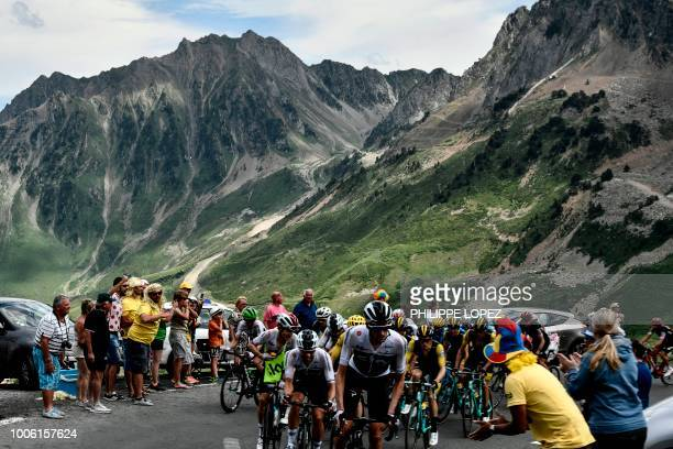Spectators cheer riders of the pack reaching the summit of the Col du Tourmalet pass during the 19th stage of the 105th edition of the Tour de France...