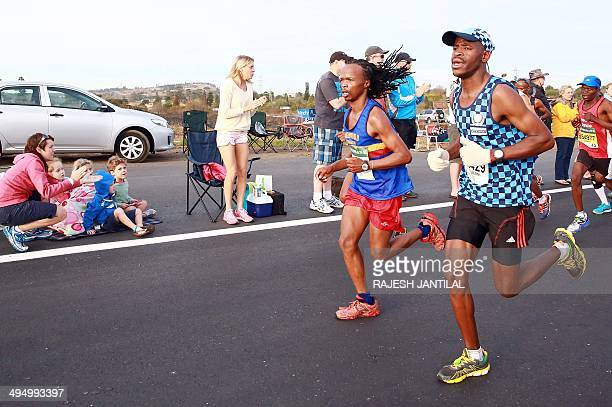 Spectators cheer runners as close to 16 000 competitors from South Africa and abroad run the 892 kilometres ultra distance Comrades Marathon from...