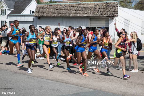 Spectators cheer the Elite women as they make their way past the 6 mile mark of the Boston Marathon on April 17 2017 in Framingham Massachusetts