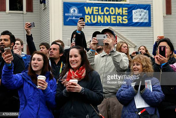 Spectators cheer the mobility impaired division as they leave the starting line in Hopkinton Mass The 119th Boston Marathon is run on Monday April 20...