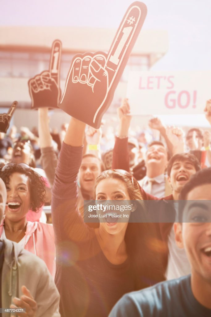 Spectators cheering at sporting event : Stock Photo