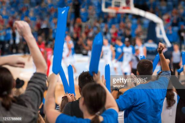spectators cheering in stadium - nba stock pictures, royalty-free photos & images