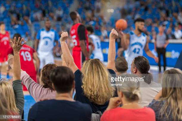 spectators cheering in stand - nba stock pictures, royalty-free photos & images