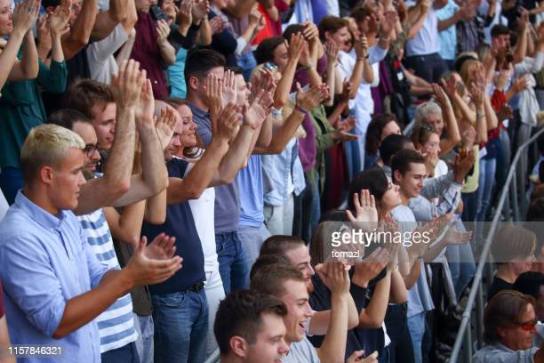 spectators clapping on a stadium - sports round stock pictures, royalty-free photos & images