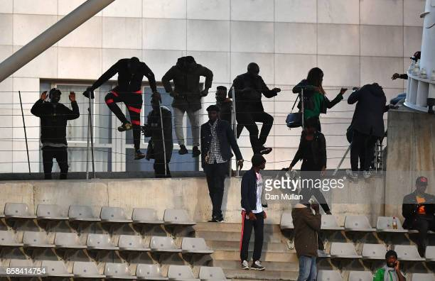 Spectators climb over railings during the International Friendly match between the Ivory Coast and Senegal at the Stade Charlety on March 27 2017 in...