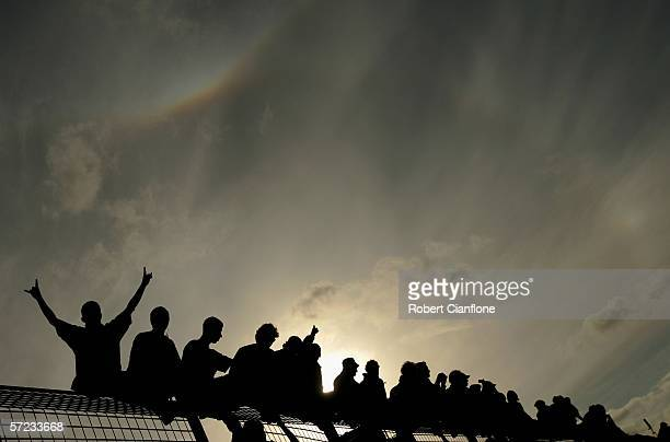 Spectators climb the fence on the pit straight after the Australian Formula One Grand Prix at the Albert Park Circuit on April 02 2006 in Melbourne...