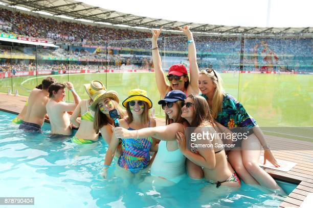 Spectators cool off in the pool at the Gabba Pool Deck during day three of the First Test Match of the 2017/18 Ashes Series between Australia and...