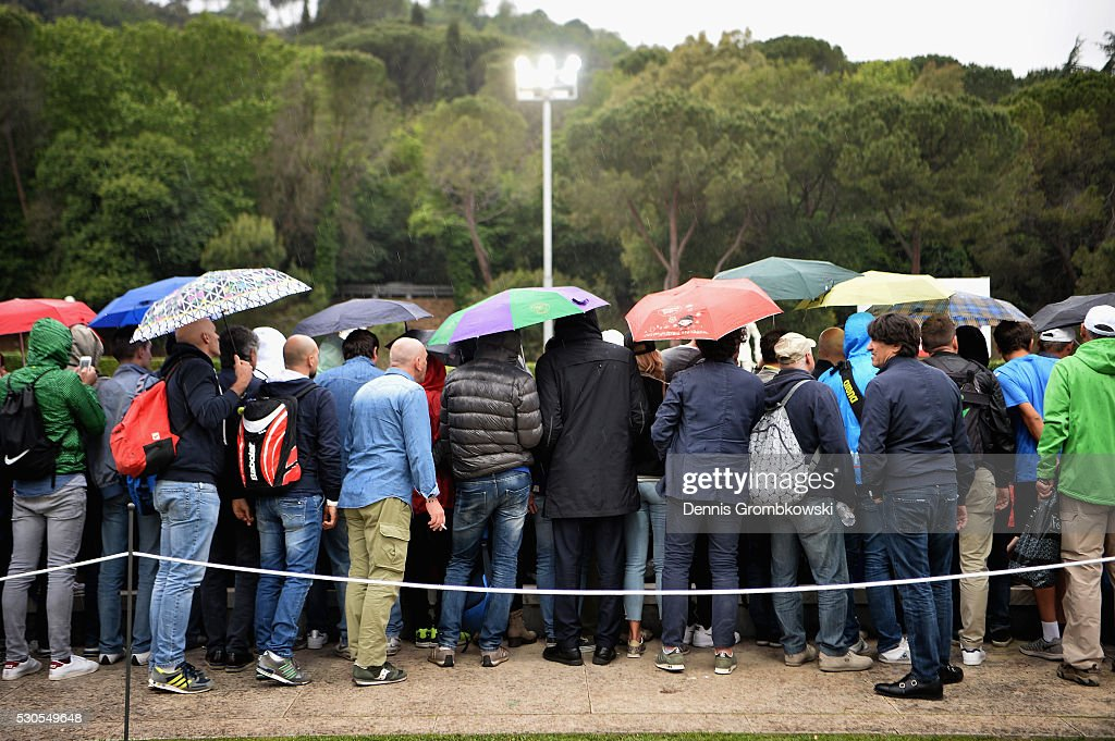 Spectators cover under umbrellas as rain falls on Day Four of The Internazionali BNL d'Italia on May 11, 2016 in Rome, Italy.
