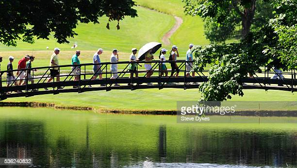 Spectators cross a foot bridge during round three of the 2016 NCAA Division I Men's Golf Championship at Eugene Country Club on May 31 2016 in Eugene...
