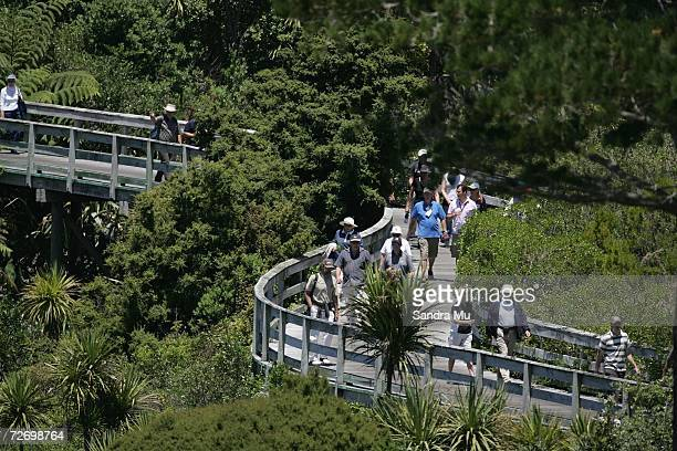Spectators cross the bridge on the 16th hole during round three of the New Zealand Open at Gulf Harbour Country Club on the Whangaparoa Peninsula...