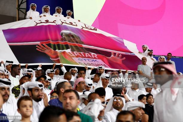 Spectators display a banner for high jumper Mutaz Essa Barshim of Qatar during day eight of 17th IAAF World Athletics Championships Doha 2019 at...