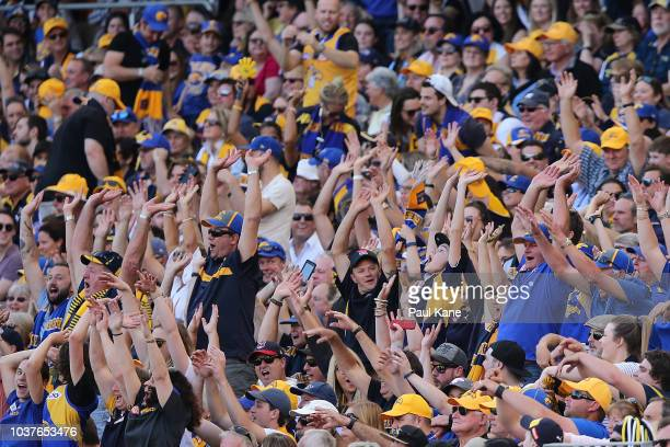 Spectators do a Mexican wave during the AFL Preliminary Final match between the West Coast Eagles and the Melbourne Demons on September 22 2018 in...