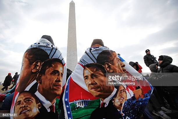 Spectators draped in Barack Obama towels gather around the grounds of the Washington Monument during the inauguration of Obama as the 44th president...