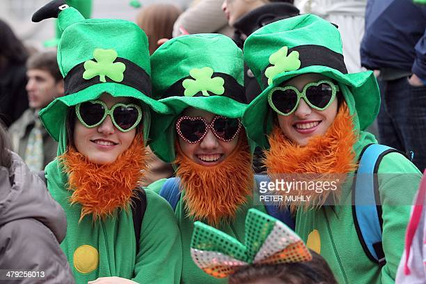 Spectators dressed as leprechauns attend St Patrick's Day parade in Dublin on March 17 2014 More than 100 parades are being held across Ireland to...