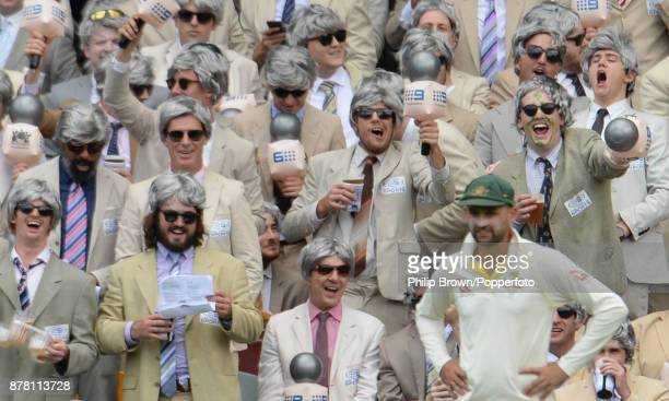 Spectators dressed as Richie Benaud yell at Nathan Lyon of Australia on the second day of the first Ashes cricket test match between Australia and...