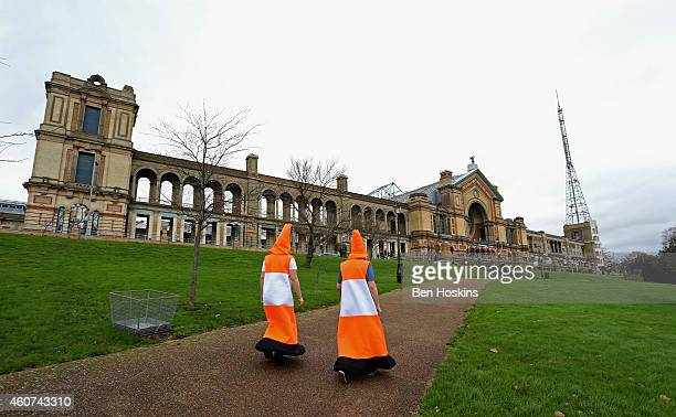 Spectators dressed as traffic cones make their way to the venue on day four of the 2015 William Hill PDC World Darts Championships at Alexandra...
