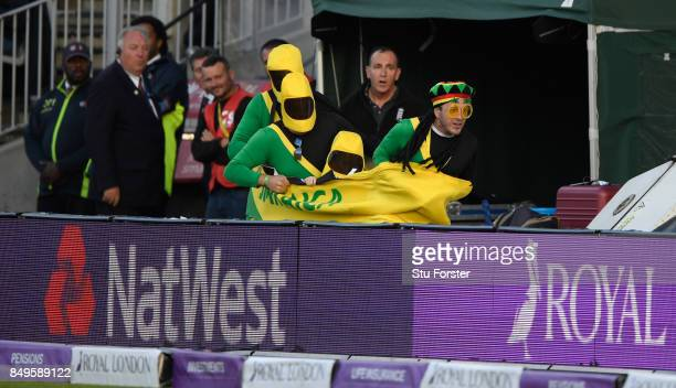 Spectators dressed up as the Jamaica Bobsleigh team make a break for it round the boundary during the 1st Royal London One Day International match...