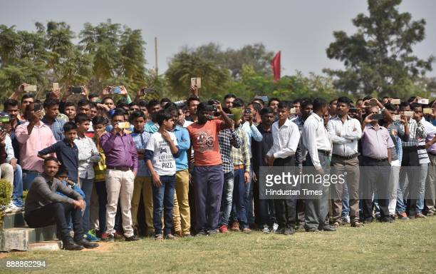 Spectators during the celebration of 257th Corps Day of Army Service Corps at Agram ground on December 9 2017 in Bengaluru India Motorcycle stunts by...