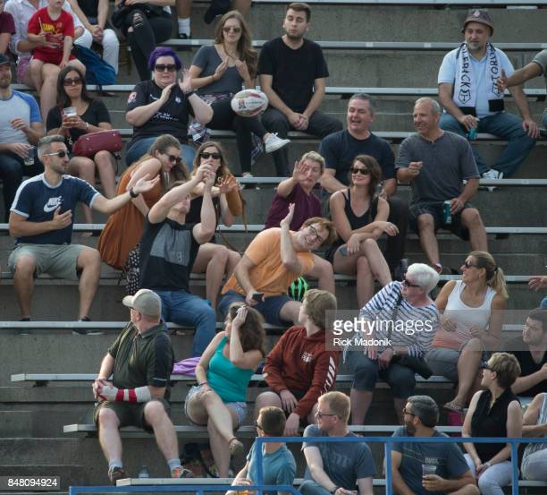 Spectators either each for or duck as the ball comes into the stands The Toronto Wolfpack ist half action as they host the final home game of the...