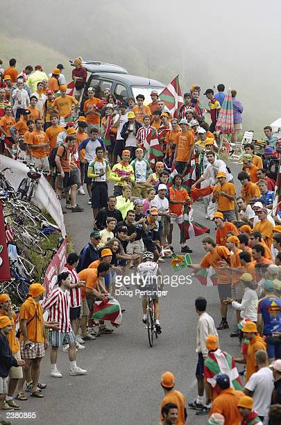 Spectators encroach onto the course to encourage Michael Blaudzun of Denmark, riding for CSC, during stage 15 of the Tour de France from...