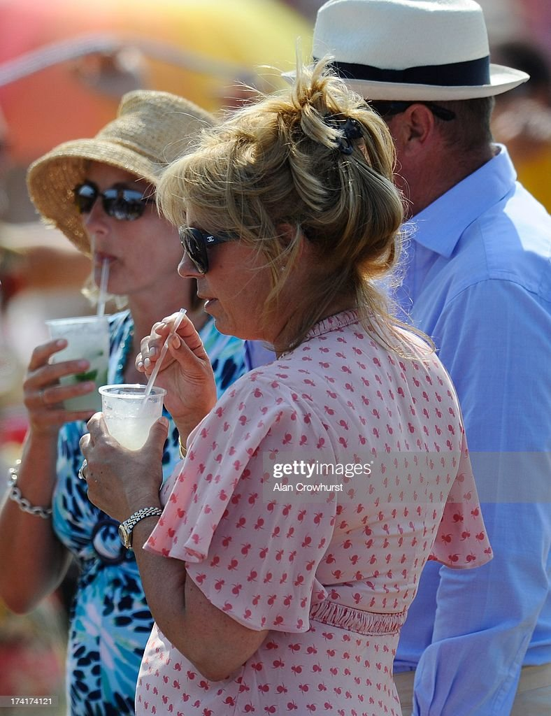 Spectators enjoy cold drinks on a hot day during the The Veuve Clicquot Gold Cup for the British Open Polo Championship Final between Dubai and Zacara at Cowdray Park Polo Club on July 21, 2013 in Midhurst, England.