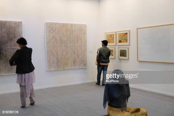 Spectators enjoy paintings and art installations at a booth curating Bombay-based artists at the India Art Fair 2018 held on the Okhla NSIC grounds...