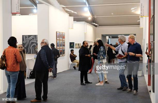 Spectators enjoy paintings and art installations at the India Art Fair 2018 held on the Okhla NSIC grounds in New Delhi on February 9th 2018 The...